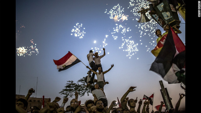As fireworks burst overhead, Egyptians in Tahrir Square celebrate Mohamed Morsi's election on Sunday.