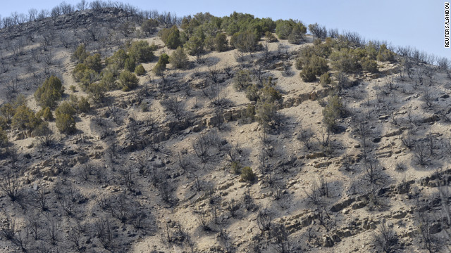 Burned<br /> 1000<br /> -out terrain from the Dump Fire fills a hillside near Saratoga Springs, Utah on Saturday.