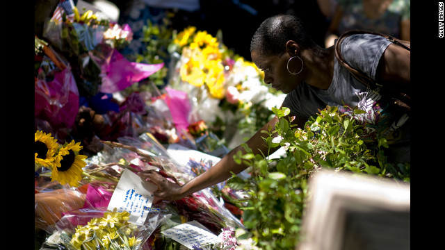 Jackson's death caused an outpouring of grief from fans. Here, a fan places flowers at a makeshift memorial outside the Jackson family compound in Encino, California, the day after his death.