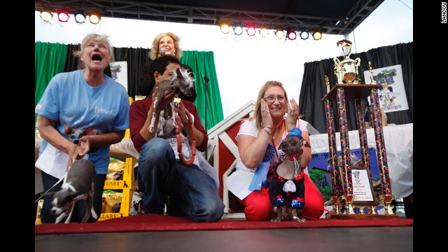 Bev Nicholson, right, of Peterborough, England, reacts after Mugly, her 8-year-old Chinese crested, won the World's Ugliest Dog title.