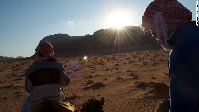 "Nick Wade traveled from Wadi Rum to Aqaba by camel. ""There is the movement of the sun, and the interplay of light and shadow, and that defines your waking hours,"" he says."