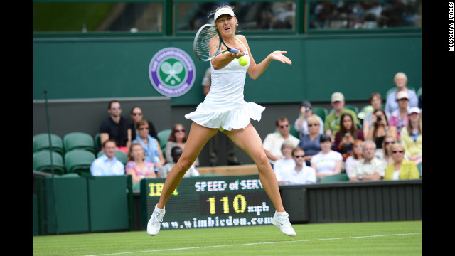 Russia's Maria Sharapova plays a forehand shot during her match against Australia's Anastasia Rodionova on June 25.