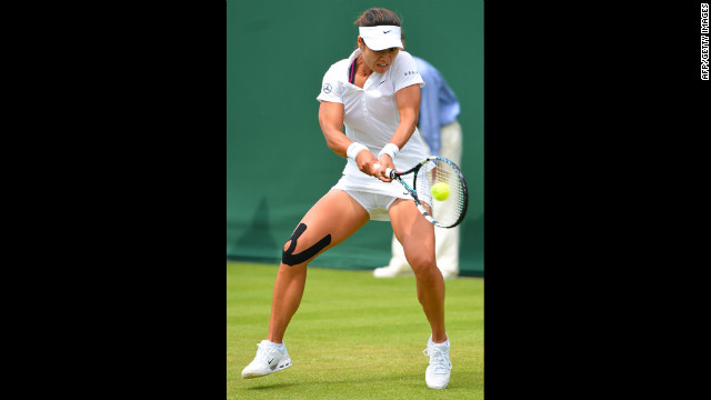 China's Li Na plays a shot during her first-round women's singles match against Kazakhstan's Ksenia Pervak on June 25. Li went on to win the match.