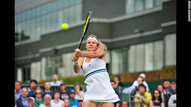 Russia's Maria Kirilenko plays a double-handed backhand shot during her first-round women's singles match against Romania's Alexandra Cadantu June 25. Kirilenko won the match.