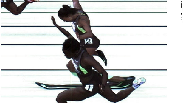 Jeneba Tarmoh, foreground, and Allyson Felix cross the finish line Sunday in the women's 100 meters in Eugene, Oregon.