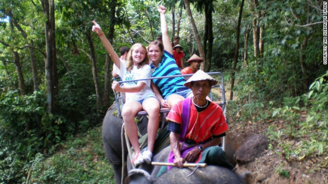 "Monica and Kara Disberger ride an elephant in Phuket, Thailand. The family's traveling lifestyle is ""within the means of a lot of folks,"" says Dennis Disberger. ""You just budget."""