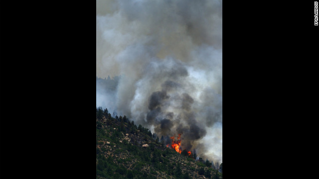 A portion of the Waldo Canyon fire burns out of control in the hills west of<br /> 1000<br />  Manitou Springs on Monday.