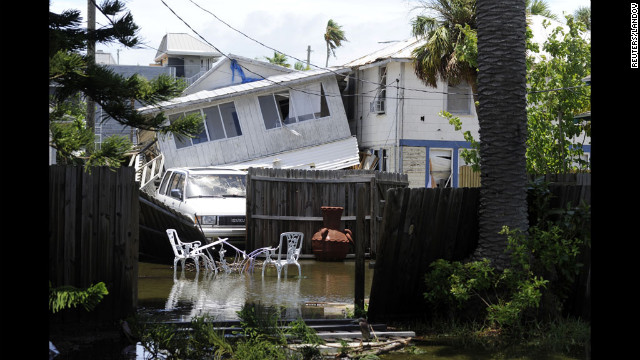 Structural damage is apparent in Pass-A-Grille Beach after an apparent tornado Sunday night.