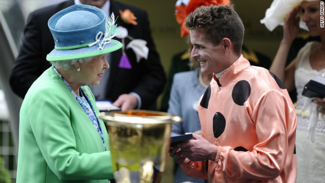 Jockey Luke Nolen is congratulated by Queen Elizabeth II after riding Black Caviar to a narrow win in the Diamond Jubilee Stakes.