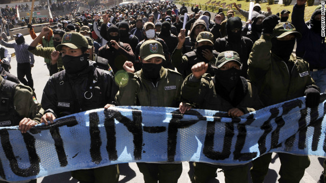 Police officers on strike march along the streets of La Paz, Bolivia, on June 25, 2012.