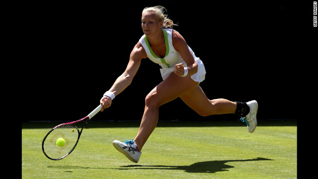 Dutch player Kiki Bertens returns during her ladies' singles first-round match against the Czech Lucie Safarova on June 26.