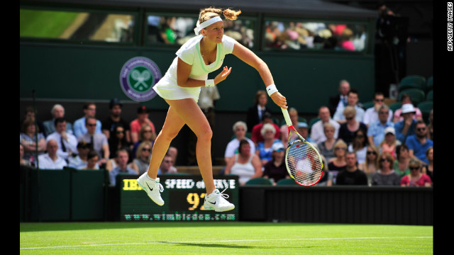 Petra Kvitova of the Czech Republic is caught in midair after serving to Uzbekistan's Akgul Amanmuradova on June 26.