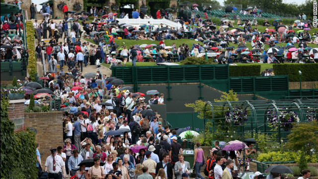 Crowds stream into the All England Lawn Tennis Club for the second day of play June 26.