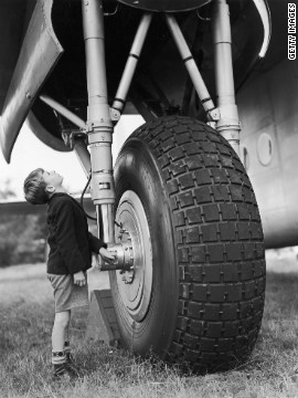 Eight-year-old David Bailey stands by the undercarriage of an Avro York transport plane at the Farnborough Airshow rehearsal in 1950.