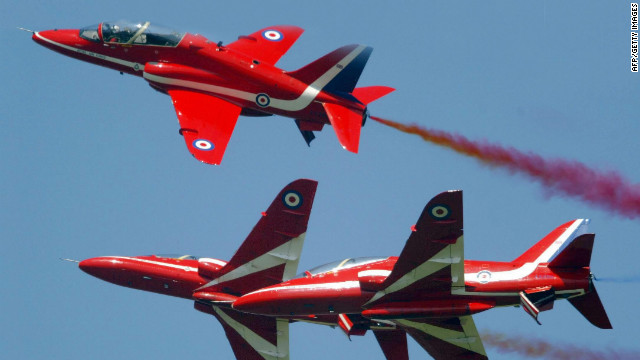Members of the British Royal Airforce's &quot;Red Arrows&quot; aerial display perform stunts over Farnborough in 2004.