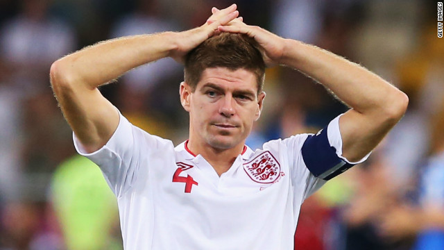 Captain Steven Gerrard stands dejected following England's exit from Euro 2012 on penalties after clinging on for most of their quarterfinal match with Italy. The team's performance drew much criticism, as they surrendered possession and territory in a defensive display, and prompted a debate about a change of direction for the national team.<br/><br/>