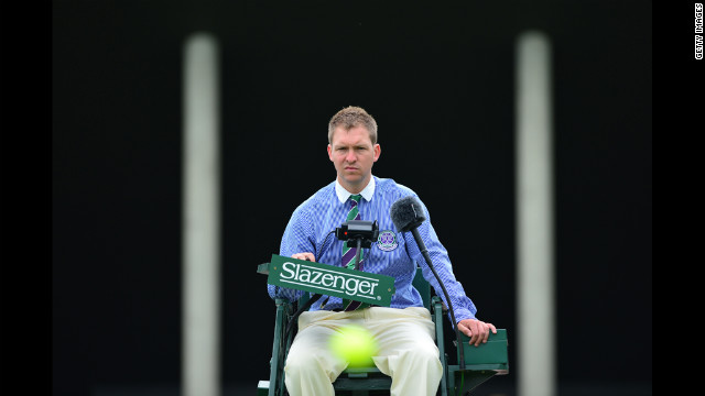 Court 5 umpire sitting in his chair on the second day of the 2012 Wimbledon Championships tennis tournament June 26.