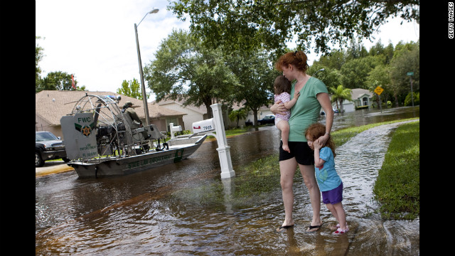 A mother and her children prepare evacuate the New Port Richey, Florida, area.
