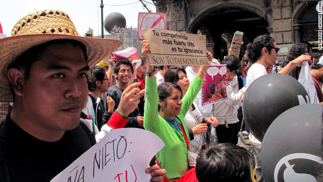 Youth demonstrators march in Mexico City, protesting presidential candidate Enrique Pena Nieto.
