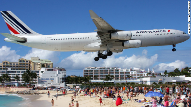 "Plane spotting aviation enthusiasts trot the globe capturing stunning photos of aircraft like this one from the Caribbean island of St. Maarten. Maho Beach is world famous for its low flying aircraft. ""If you like airplanes, Maho is like the cherry on top"" of a beautiful beach vacation, says Justin Schlechter, a 747 pilot who's visited Maho several times."