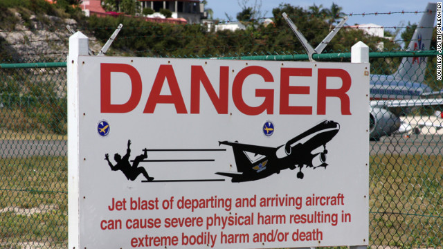 When pilots preparing for take off from St. Maarten's Princess Juliana International Airport rev their engines, daredevils sometimes stand against the airport fence and hold on. The jet blast is so close and powerful that it can throw people off the fence and onto the ground.
