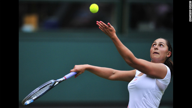 Austria's Tamira Paszek serves during her first round women's singles match against Denmark's Caroline Wozniacki on June 26.
