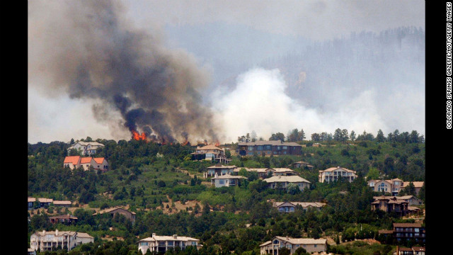 Trees burn on a ridge above Cedar Heights in Colorado Springs, Colorado, on Sunday, June 24.
