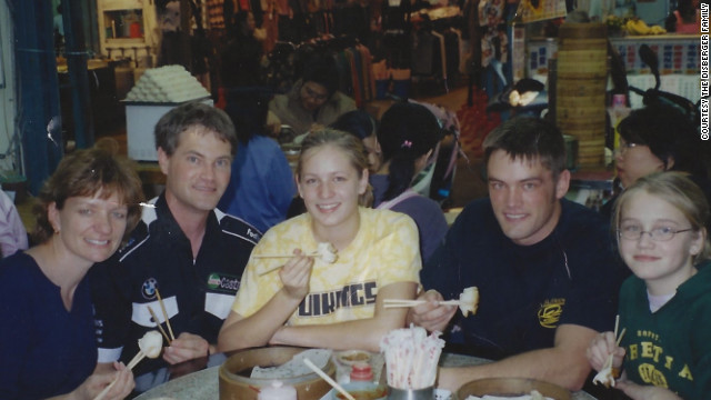 Left to right, Martha, Dennis, Kara, Joel and Monica Disberger have flown a total of 7.5 million miles, according to United Airlines. In this undated snapshot, they enjoyed a meal in Taiwan.