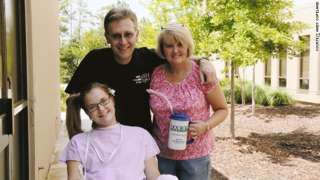 Flesh-eating bacteria patient Aimee Copeland goes outside Doctors Hospital in Augusta, Georgia, for the first time with her parents, Andy and Donna Copeland, on June 25.