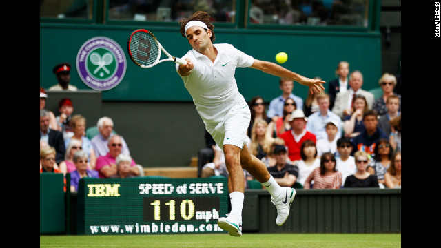 Switzerland's Roger Federer returns Fabio Fognini's serve during the gentlemen's singles second-round match on Wednesday.