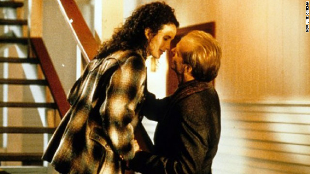 "In ""Michael,"" John Travolta plays an atypical angel whose mission is to bring cynical reporter Frank (William Hurt) and Dorothy (Andie MacDowell) together."