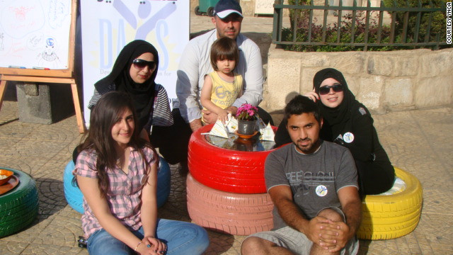 Young people gather at a coffee table made of car tires in the center of Nabatieh, southern Lebanon. The initative began when the army shooting of a cleric recently raised tensions around the country.