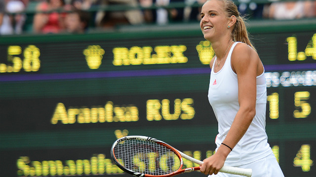 Arantxa Rus celebrates her second-round victory over Australia's Samantha Stosur on day three at Wimbledon.