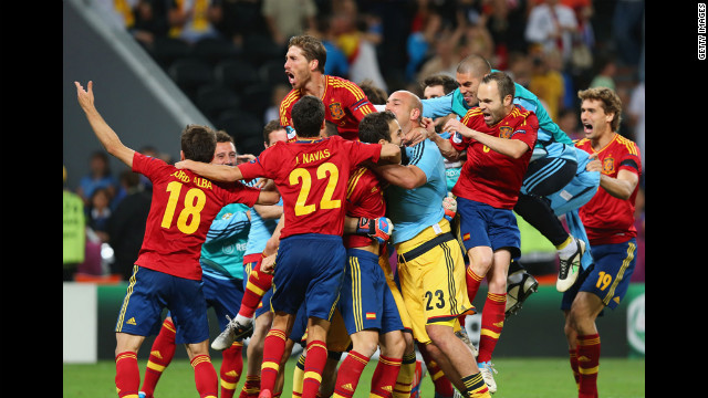 The Spanish national team celebrates its win in the Euro 2012 semifinal match against Portugal at Donbass Arena in Donetsk, Ukraine, on Wednesday, June 27.