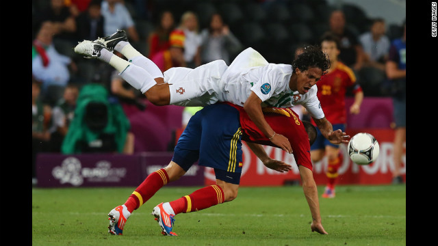 Bruno Alves of Portugal and Alvaro Negredo of Spain challenge for the ball.