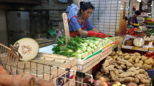 Carmen, 56, works at a vegetable stall she inherited from her mother when she died in 1999. She said that after the handover to China, the rules became stricter and outdoor vendors had to move indoors. Business isn't as strong inside, she said.