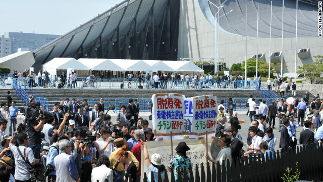 Protesters gather outside the Yoyogi gymnasium in Tokyo, the venue for TEPCO's shareholder's meeting.