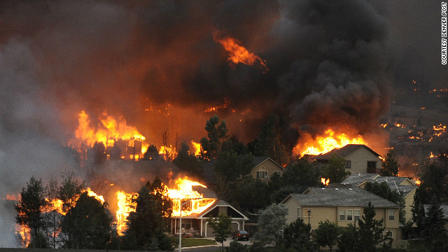 The Waldo Canyon fire spreads through a neighborhood in the hills above Colorado Springs on June 26. See more photos at <a href='http://www.denverpost.com/' target='_blank'>The Denver Post</a>.