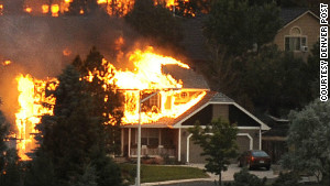 The Mganas\' home was front and center in this photo featured on the front page of the Denver Post.
