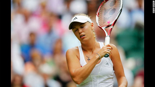 Caroline Wozniacki of Denmark reacts during her first-round match against Tamira Paszek of Austria on Wednesday.