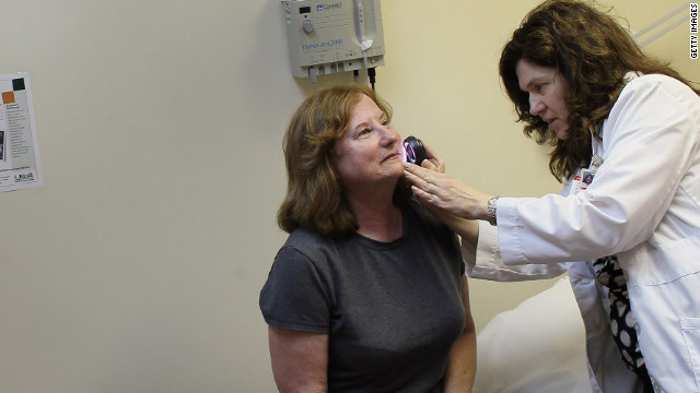  Dermatologist Jonette Keri examines Marcia Spevak Breiter for symptoms of skin cancer.