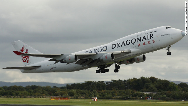 Plane spotters rave about the great photo shooting locations surrounding England's Manchester Airport. Krzysztof Tomczak, a spotter based in Poznań, Poland, captured this image of a Dragonair Cargo Boeing 747-412.