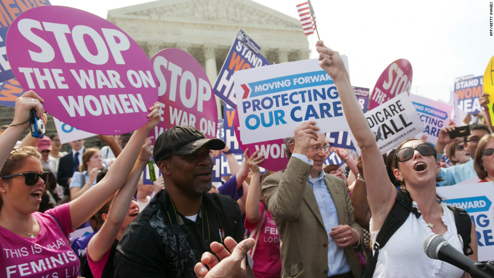 Supporters of the health care legislation celebrate after the Supreme Court upheld the constitutionality of the Patient Protection and Affordable Care Act in a 5-4 ruling Thursday, June 28.