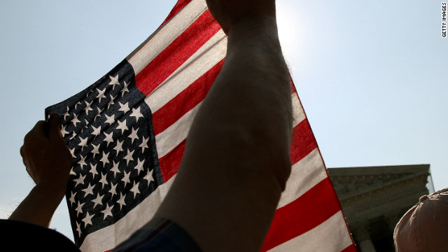 A protester holds an American flag during a demonstration in front of the U.S. Supreme Court,.