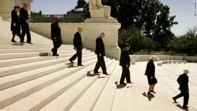 Justices file out of the Supreme Court building during funeral services for Chief Justice William Rehnquist on September 7, 2005. Following Rehnquist's death, President Bush announced Robert's new nomination to the position of chief justice.