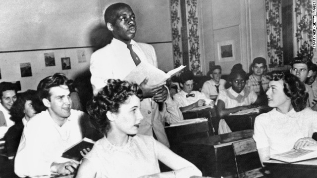 Nathaniel Steward, 17, recites his lesson surrounded by white classmates at the Saint-Dominique School, in Washington, the first school in which the Supreme Court ruling banning school segregation was applied.