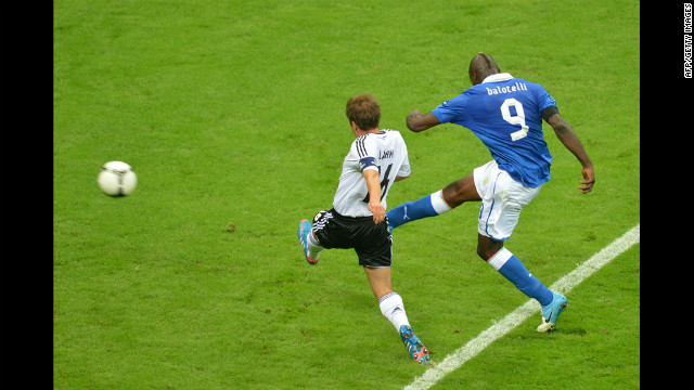 Italian forward Mario Balotelli shoots to score his second goal of the match.