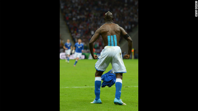 Mario Balotelli of Italy celebrates after scoring his team's second goal.