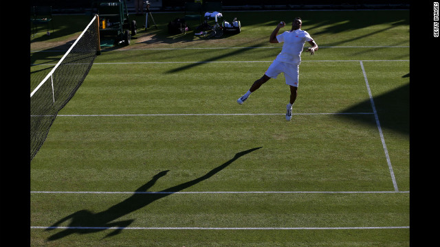Jo-Wilfried Tsonga of France celebrates winnign his men's singles second-round match against Guillermo Garcia-Lopez of Spain June 28.