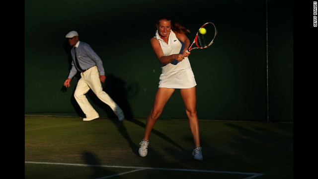 Alla Kudryavtseva of Russia and Paul Hanley of Australia during thier mixed doubles first-round match against Jonathan Marray and Anne Keothavong of Great Britain June 28.